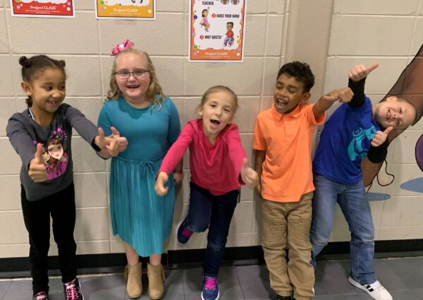 1st graders with thumbs up for Project CLASS